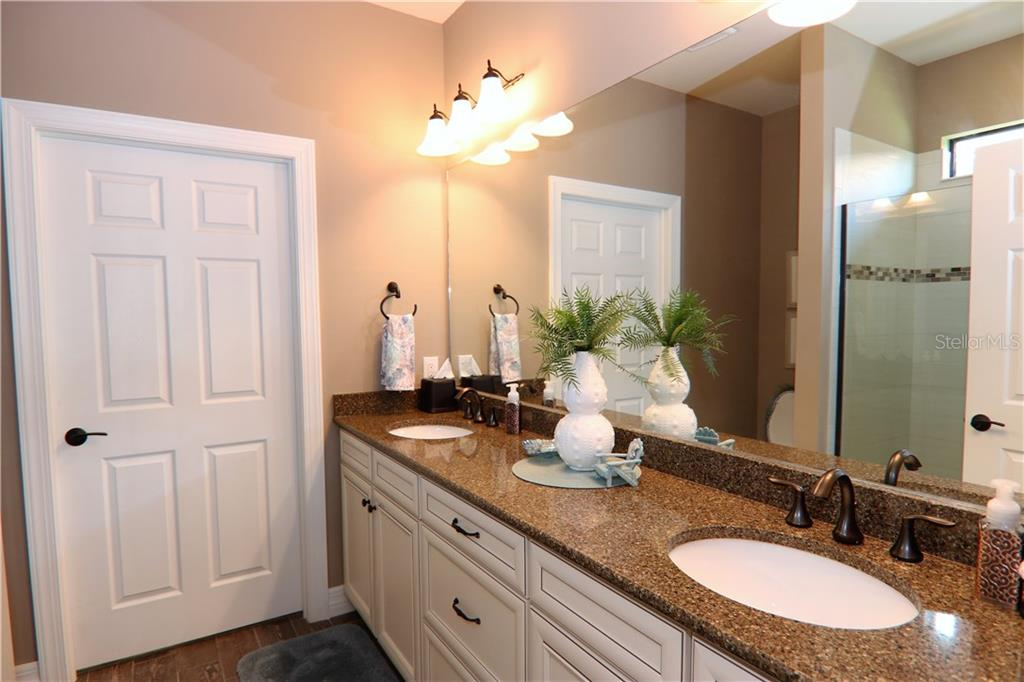 Master bathroom with quartz counter top and double sink, walk in closet - Single Family Home for sale at 13880 Lido St, Venice, FL 34293 - MLS Number is N5917319