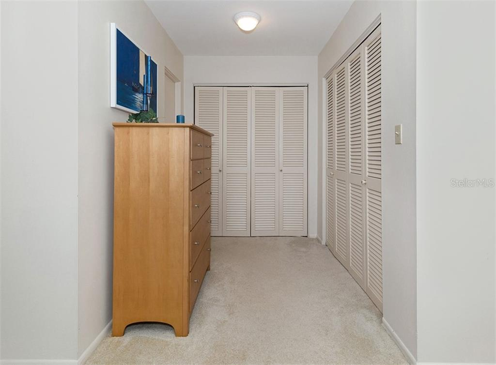 Master bedroom has 2 large closets and dressing area. - Condo for sale at 100 The Esplanade N #4, Venice, FL 34285 - MLS Number is N6100334