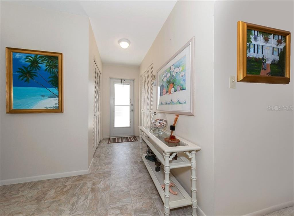 Hallway leading to rear door for easy access to community pool or public beach. - Condo for sale at 100 The Esplanade N #4, Venice, FL 34285 - MLS Number is N6100334