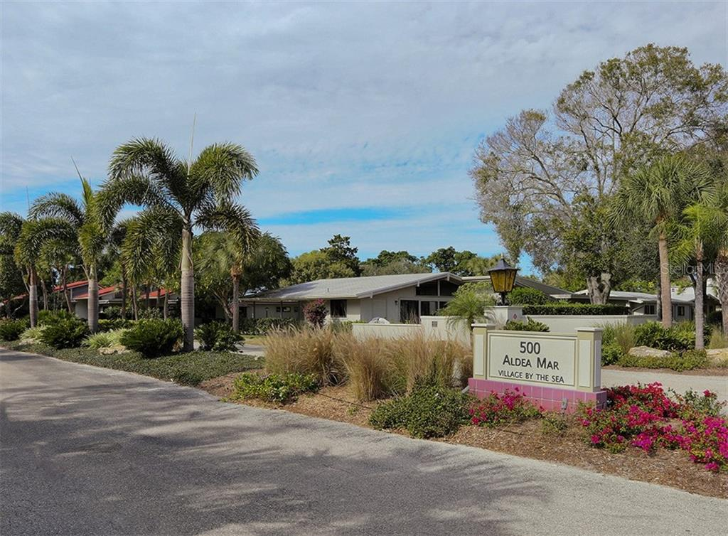Beautiful entrance, landscaping, and curb appeal throughout this special community. - Condo for sale at 500 Park Blvd S #67, Venice, FL 34285 - MLS Number is N6100360