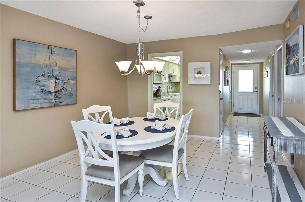 Dining room to kitchen and foyer - Condo for sale at 512 W Venice Ave #506, Venice, FL 34285 - MLS Number is N6100462