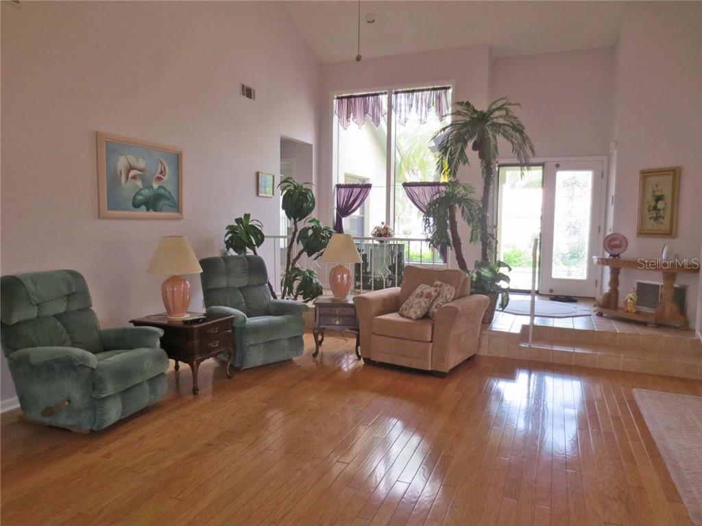 Living room to foyer - Villa for sale at 151 Inlets Blvd #151, Nokomis, FL 34275 - MLS Number is N6100469