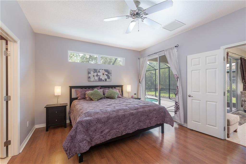 master bedroom with sliders to the pool - Single Family Home for sale at 11513 Dancing River Dr, Venice, FL 34292 - MLS Number is N6100495