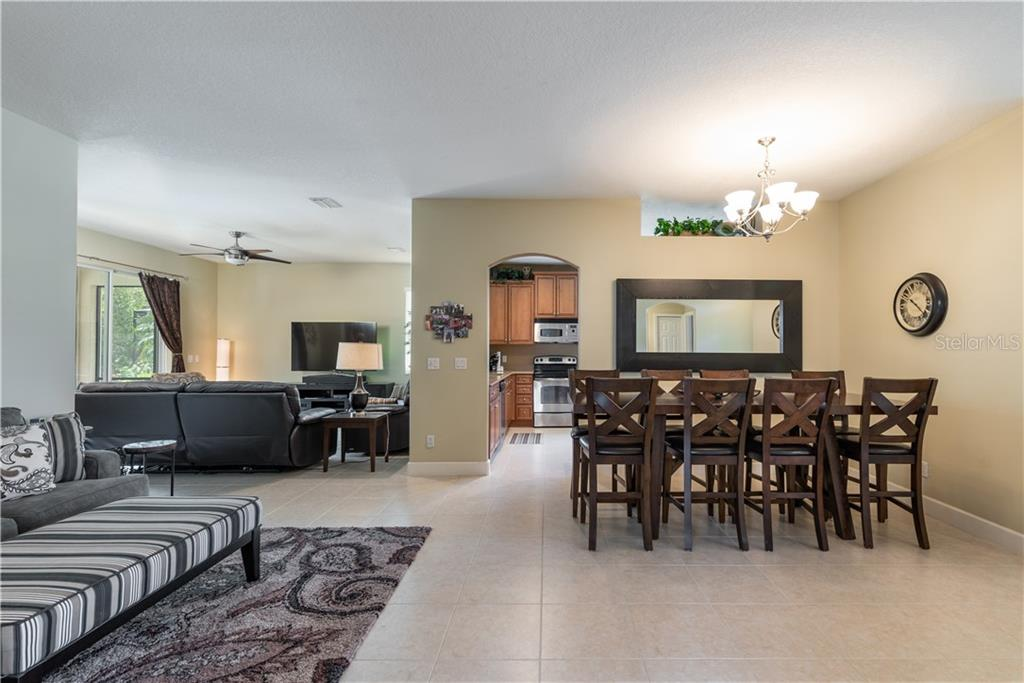 Dining room area - Single Family Home for sale at 11513 Dancing River Dr, Venice, FL 34292 - MLS Number is N6100495