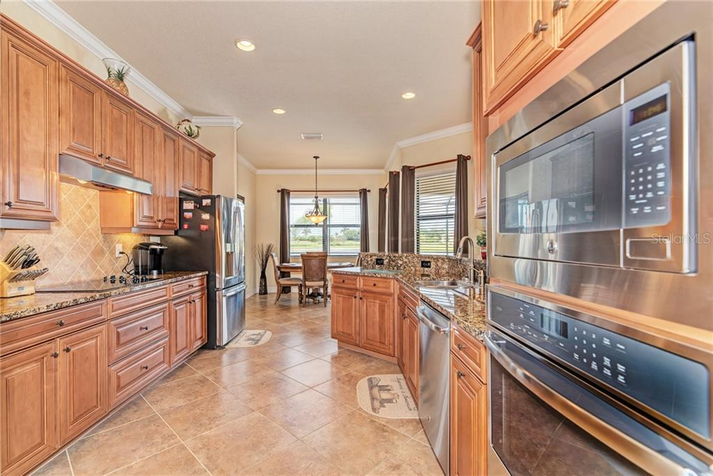 Kitchen with built in appliances - Single Family Home for sale at 20145 Cristoforo Pl, Venice, FL 34293 - MLS Number is N6100537