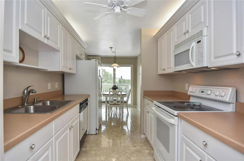 Kitchen to dinette - Condo for sale at 500 The Esplanade N #402, Venice, FL 34285 - MLS Number is N6100557