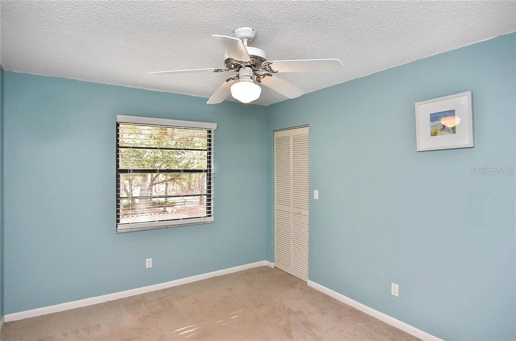 Bedroom 2 - Condo for sale at 654 Bird Bay Dr E #201, Venice, FL 34285 - MLS Number is N6101101
