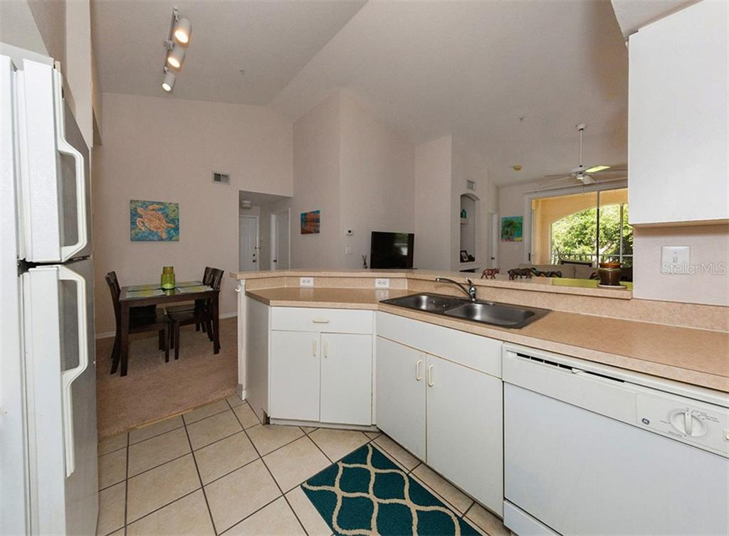 Kitchen to dining room - Condo for sale at 4106 Central Sarasota Pkwy #1028, Sarasota, FL 34238 - MLS Number is N6101168
