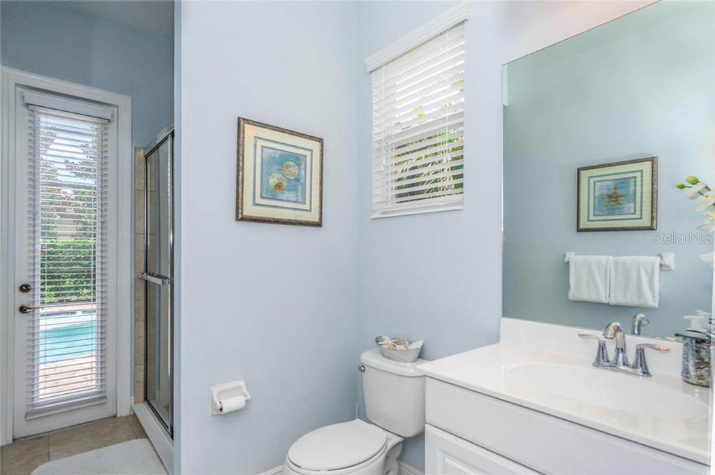 3rd Bathroom with outdoor access to pool - Single Family Home for sale at 368 Marsh Creek Rd, Venice, FL 34292 - MLS Number is N6101204
