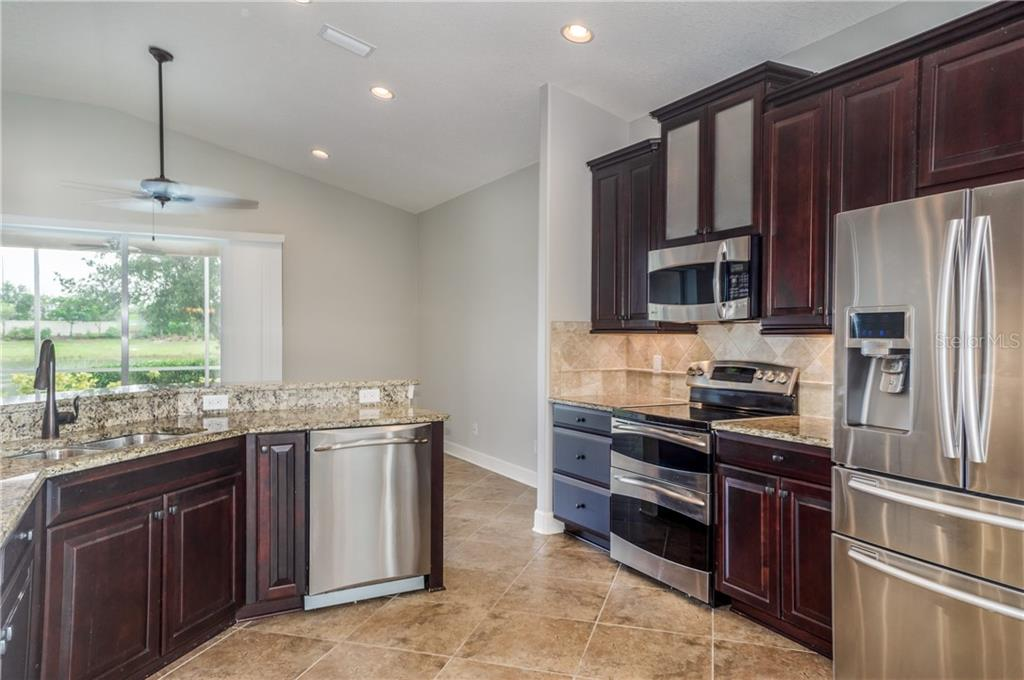 Wood Cabinetry and Granite Counters - Single Family Home for sale at 2290 Terracina Dr, Venice, FL 34292 - MLS Number is N6101301