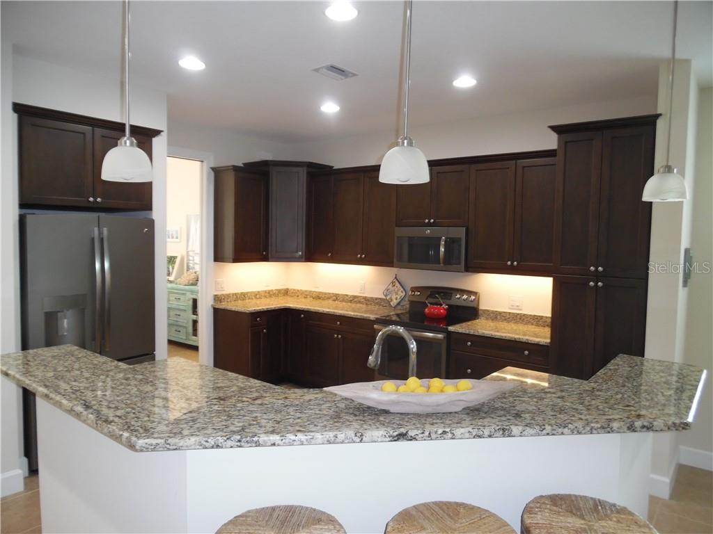 breakfast bar - Single Family Home for sale at 239 Nolen Dr, Venice, FL 34292 - MLS Number is N6101457