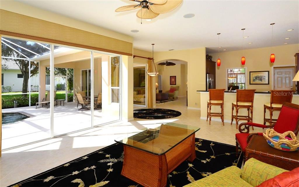 Family room to pool - Single Family Home for sale at 913 Chickadee Dr, Venice, FL 34285 - MLS Number is N6101770