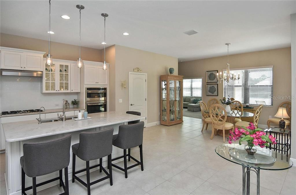 Kitchen, dining room - Single Family Home for sale at 21220 St Petersburg Dr, Venice, FL 34293 - MLS Number is N6101838