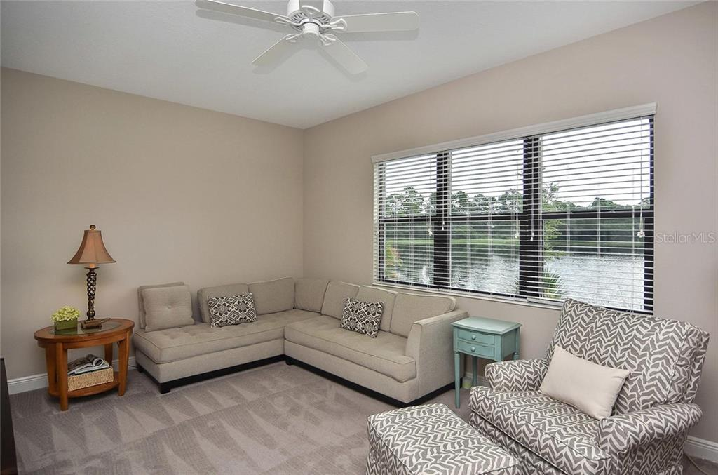 Club Room with water view - Single Family Home for sale at 21220 St Petersburg Dr, Venice, FL 34293 - MLS Number is N6101838