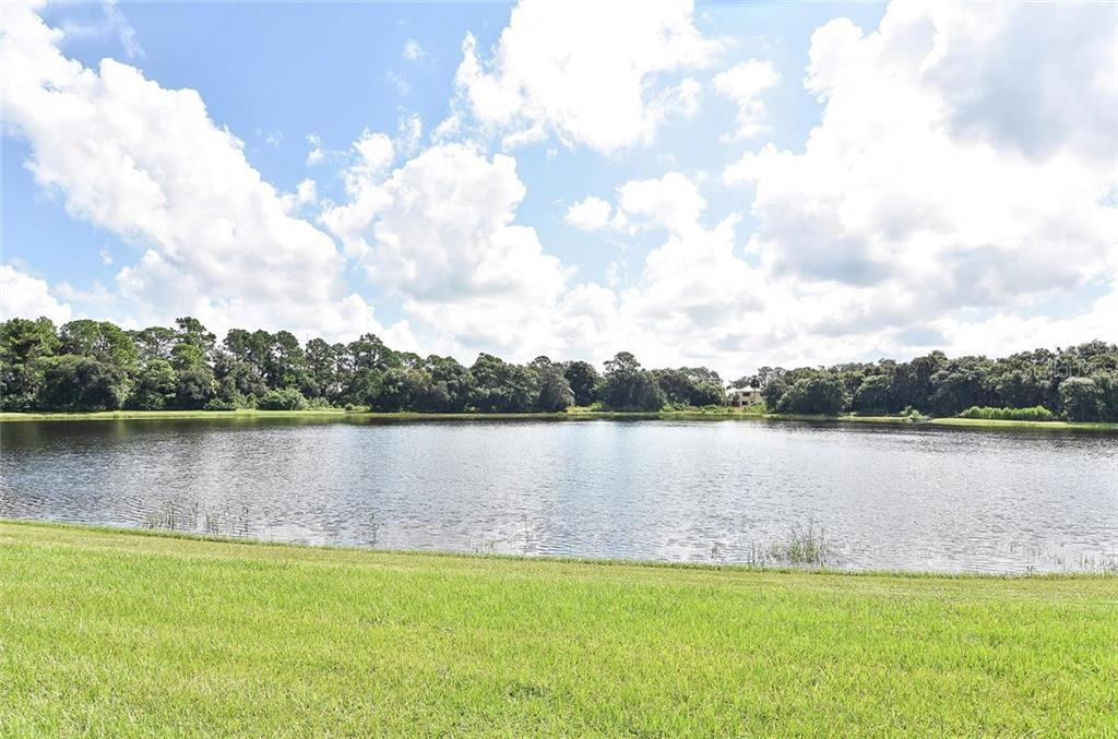 Lake view from lanai - Single Family Home for sale at 21220 St Petersburg Dr, Venice, FL 34293 - MLS Number is N6101838