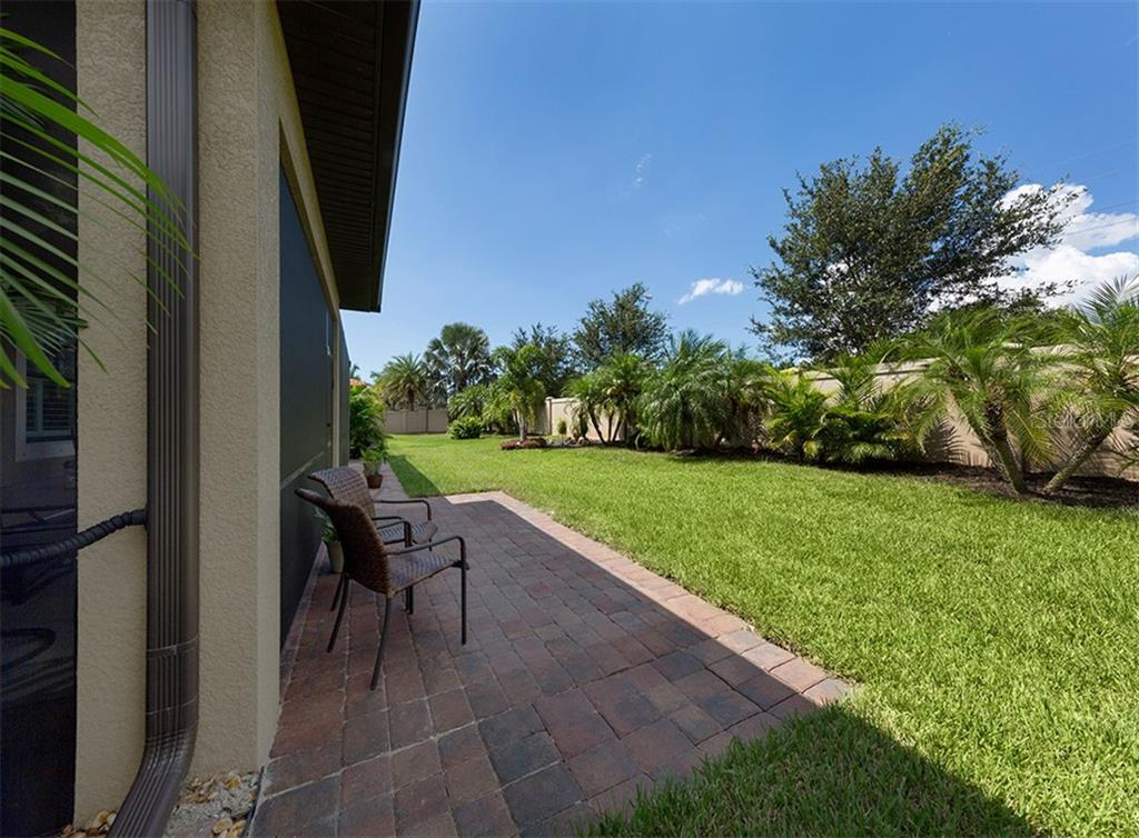 Patio, yard - Single Family Home for sale at 646 Resolute St, Nokomis, FL 34275 - MLS Number is N6102035