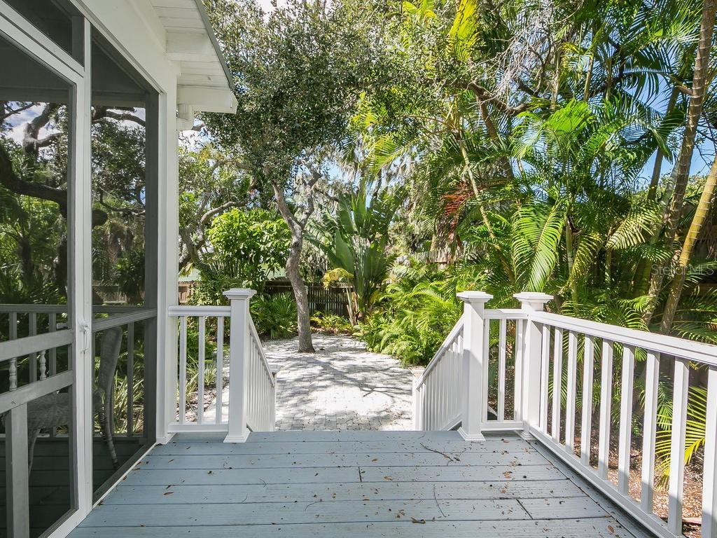 Porch to yard - Single Family Home for sale at 732 Eagle Point Dr, Venice, FL 34285 - MLS Number is N6102366