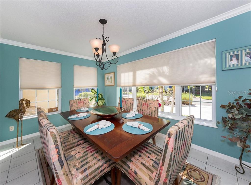 Gracious Dining Room - Single Family Home for sale at 7 Cornwell On The Gulf, Venice, FL 34285 - MLS Number is N6102542