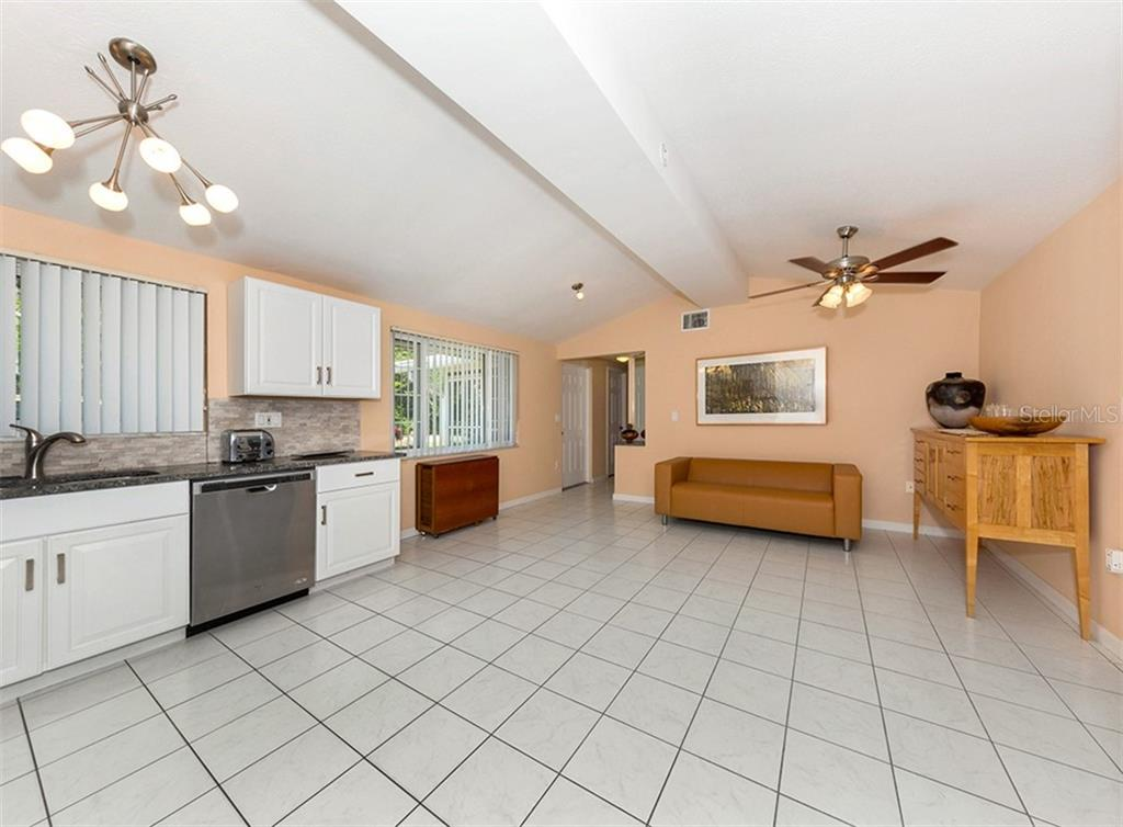 Kitchen, living room - Single Family Home for sale at 717 Guild Dr, Venice, FL 34285 - MLS Number is N6103134