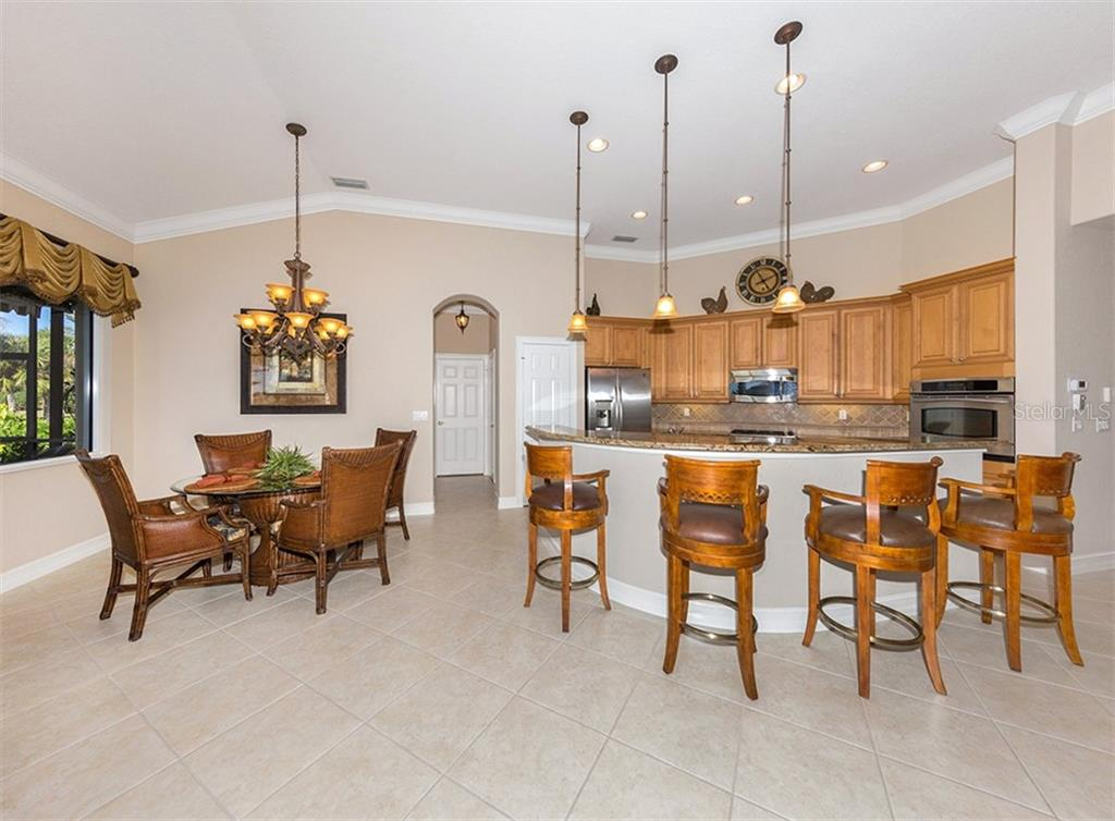 Dinette, kitchen - Single Family Home for sale at 110 Martellago Dr, North Venice, FL 34275 - MLS Number is N6103159