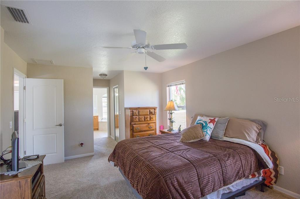 From master looking at double walk-in closets and bathroom - Single Family Home for sale at 6612 Deer Run Rd, North Port, FL 34291 - MLS Number is N6103231