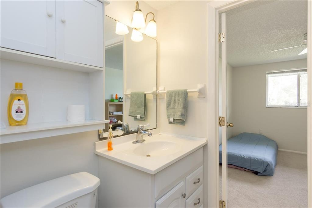 guest bath, has door to 2nd Bedroom - Single Family Home for sale at 3656 Clematis Rd, Venice, FL 34293 - MLS Number is N6103558