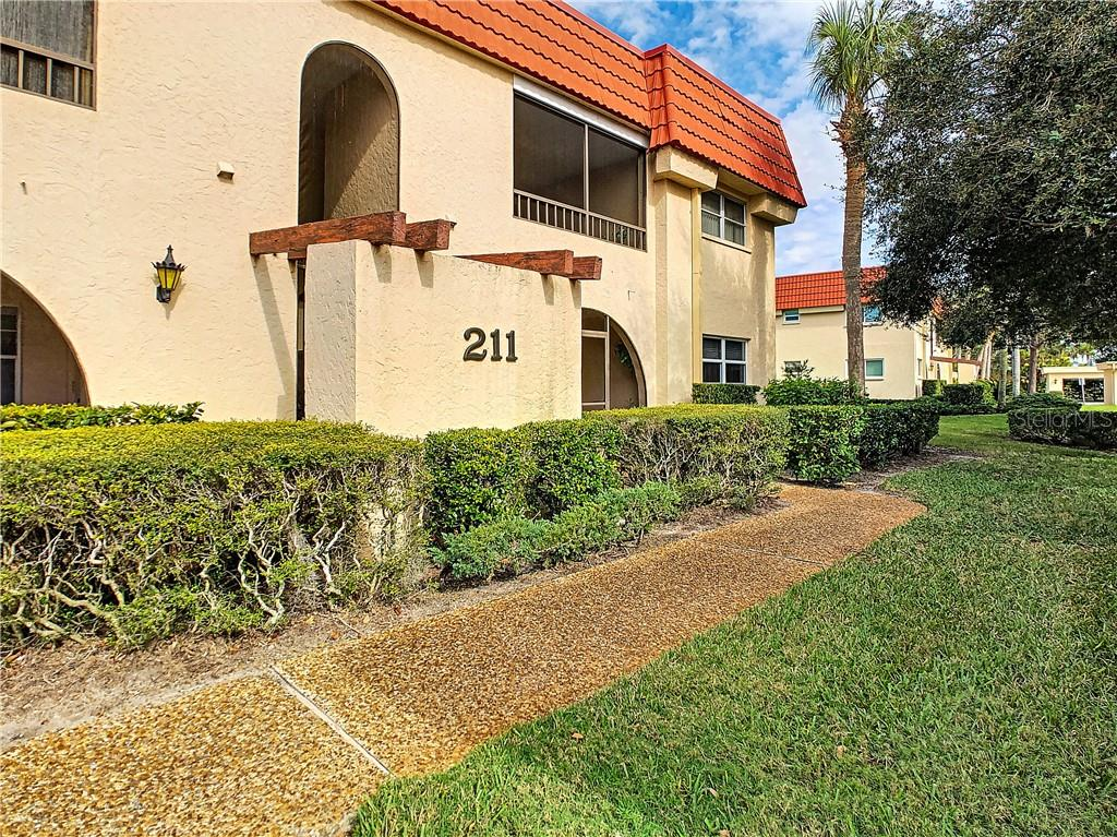 Front of condo complex - Condo for sale at 211 Rubens Dr #h, Nokomis, FL 34275 - MLS Number is N6103629