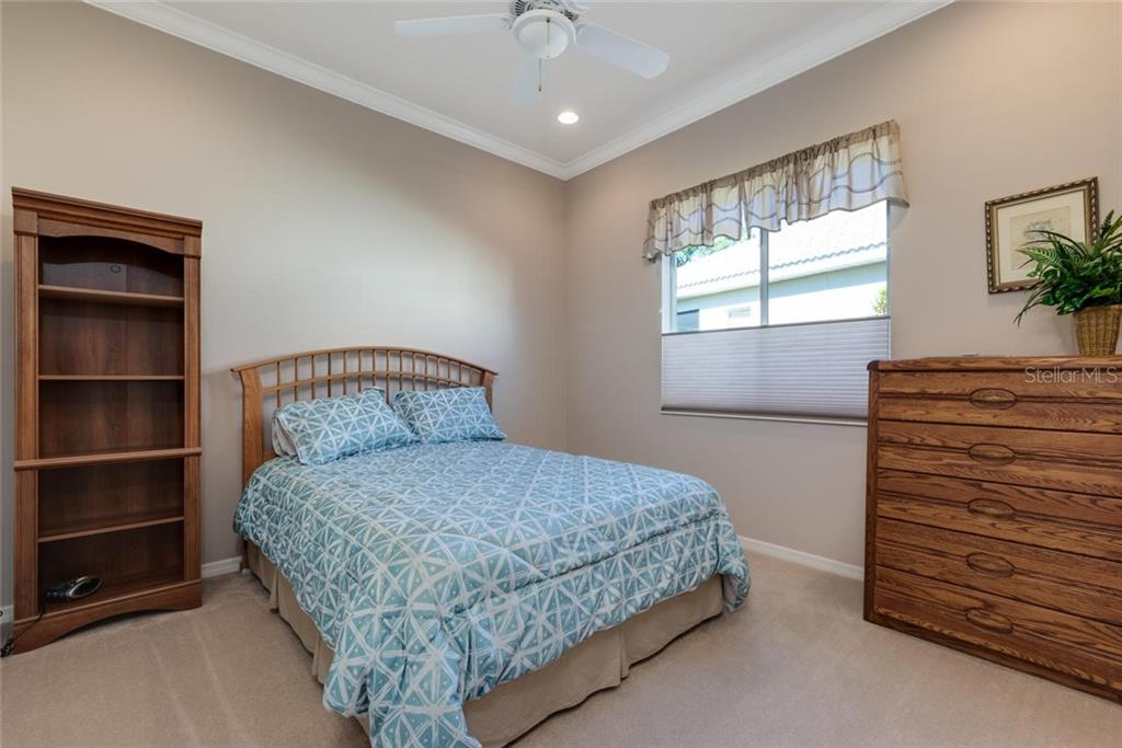 Bedroom 2 - Single Family Home for sale at 821 Adonis Pl, Venice, FL 34292 - MLS Number is N6104303