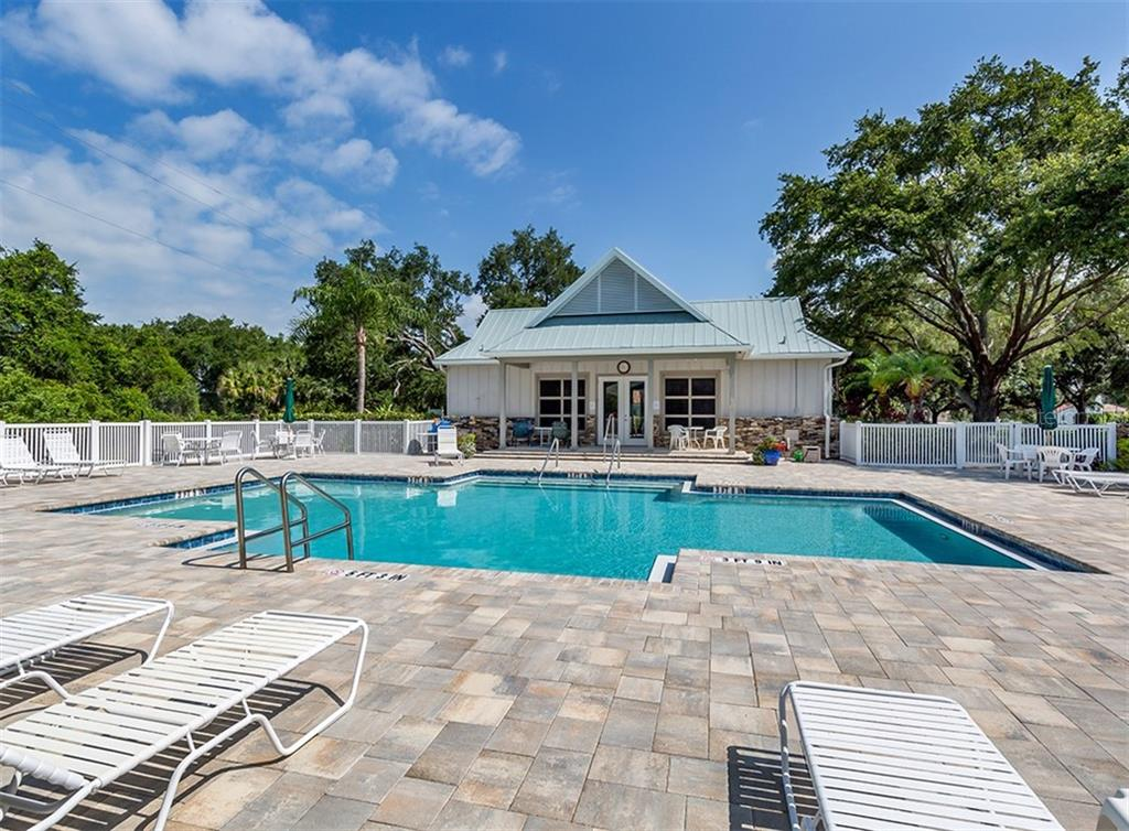 Clubhouse, community pool - Single Family Home for sale at 836 Connemara Cir, Venice, FL 34292 - MLS Number is N6105684