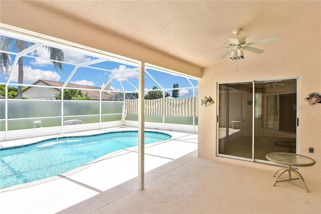 Lanai with sliders to master bedroom - Single Family Home for sale at 2232 E Village Cir, Venice, FL 34293 - MLS Number is N6105697