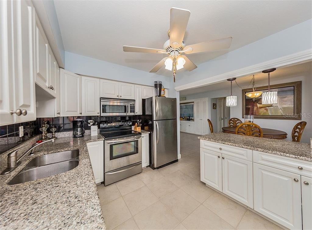 Kitchen to dining room - Single Family Home for sale at 409 Darling Dr, Venice, FL 34285 - MLS Number is N6105760