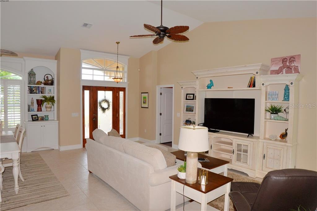 Living room to entry - Single Family Home for sale at 537 Lake Of The Woods Dr, Venice, FL 34293 - MLS Number is N6106043