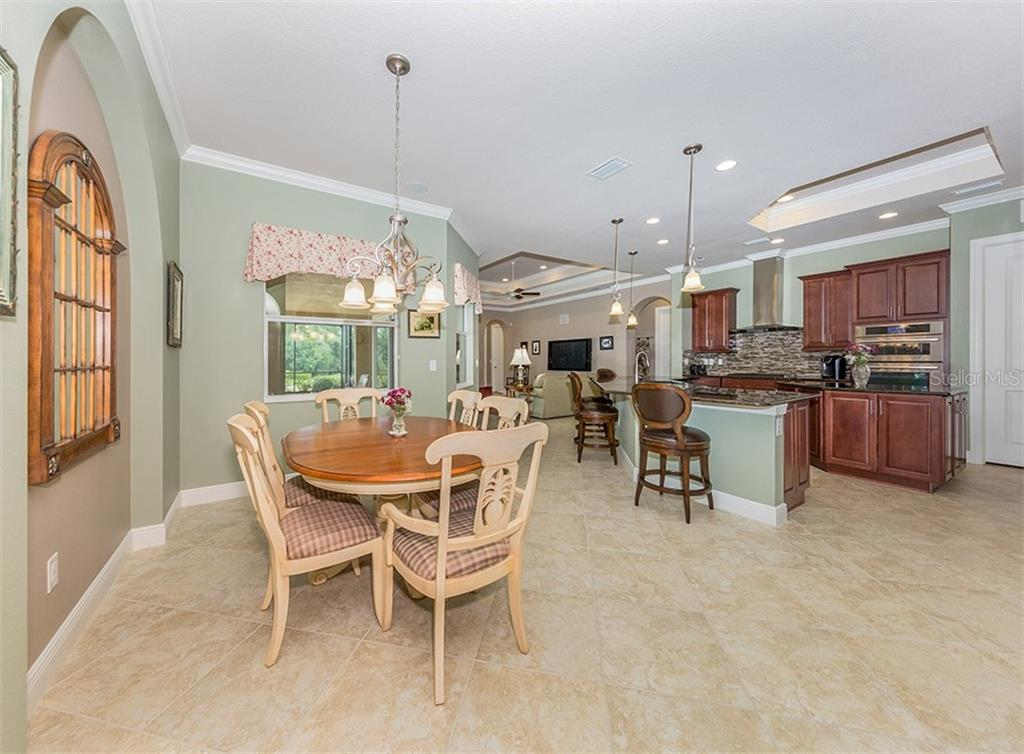 Dinette, kitchen - Single Family Home for sale at 189 Portofino Dr, North Venice, FL 34275 - MLS Number is N6106071