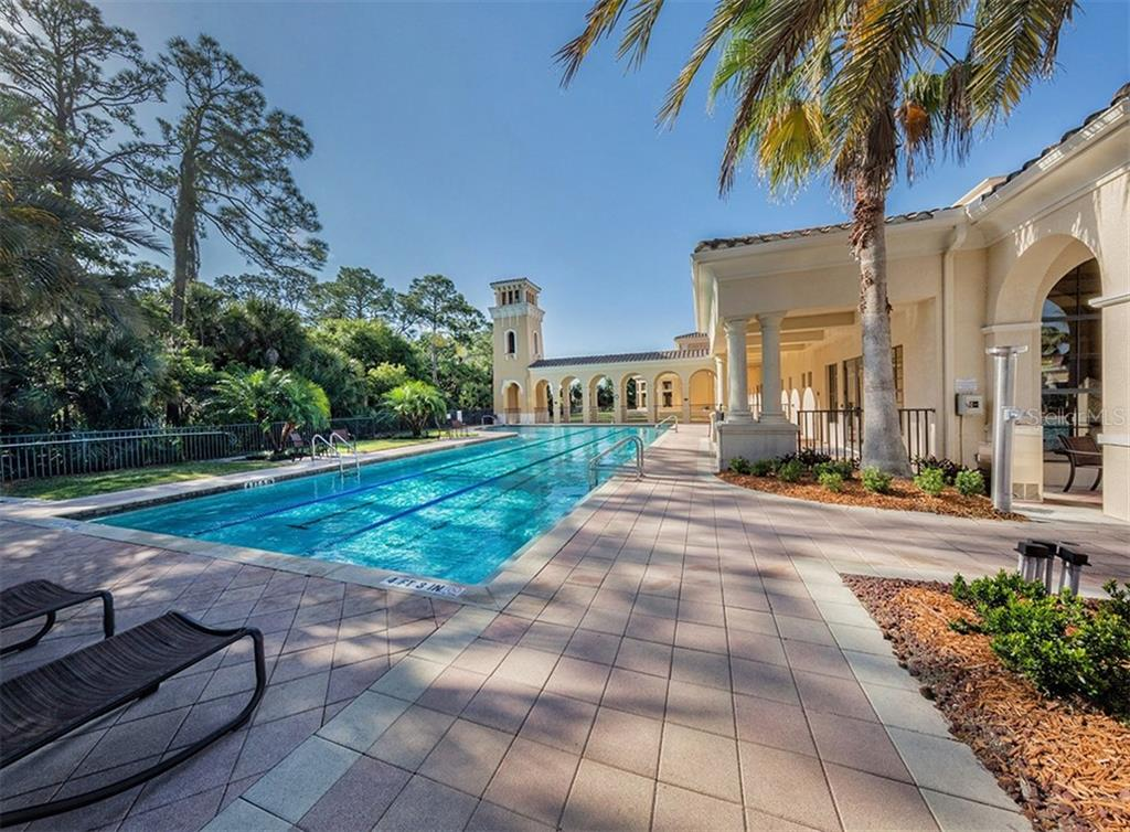 Community lap pool, clubhouse - Single Family Home for sale at 189 Portofino Dr, North Venice, FL 34275 - MLS Number is N6106071