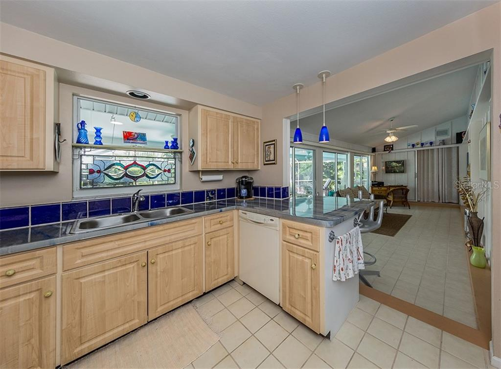 Kitchen to Florida room - Single Family Home for sale at 429 Beach Park Blvd, Venice, FL 34285 - MLS Number is N6106119