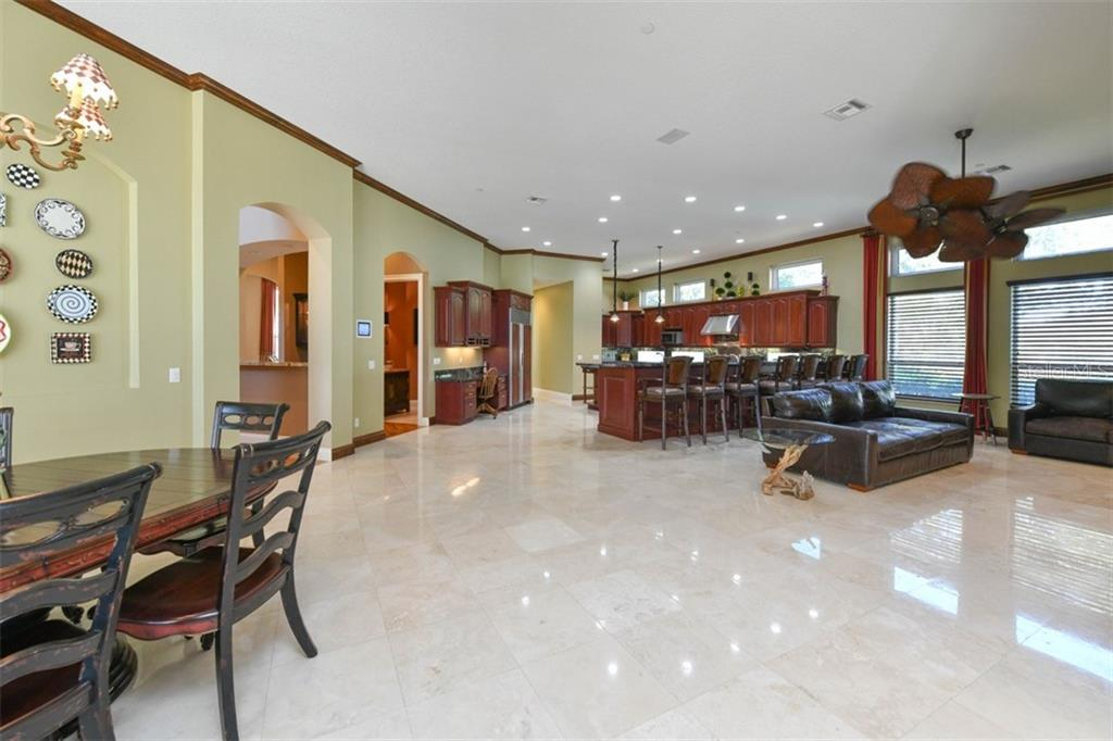 Family room/kitchen - Single Family Home for sale at 854 Macewen Dr, Osprey, FL 34229 - MLS Number is N6106697