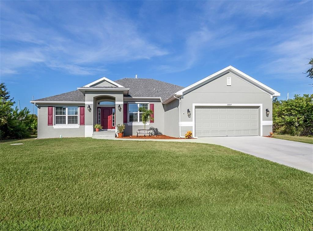 Front elevation - Single Family Home for sale at 10449 Redondo St, Port Charlotte, FL 33981 - MLS Number is N6107406