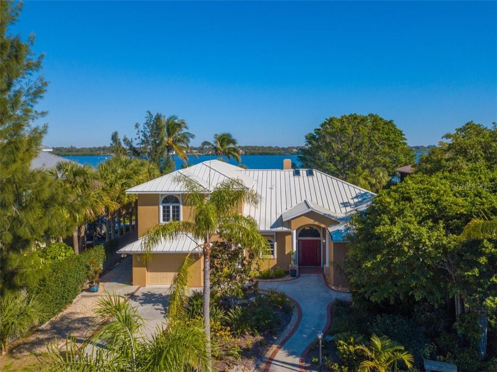 Front elevation - Single Family Home for sale at 7785 Manasota Key Rd, Englewood, FL 34223 - MLS Number is N6107786