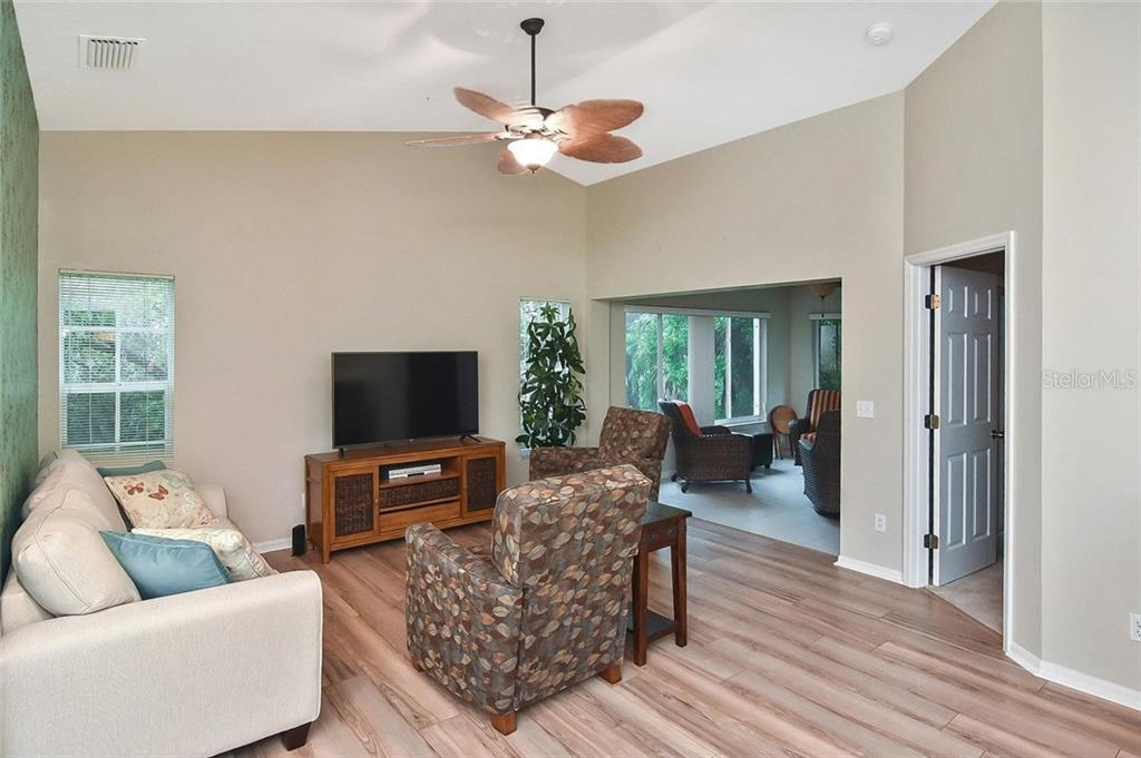 Dining room to bedroom 3 - Condo for sale at 817 Montrose Dr #201, Venice, FL 34293 - MLS Number is N6107943