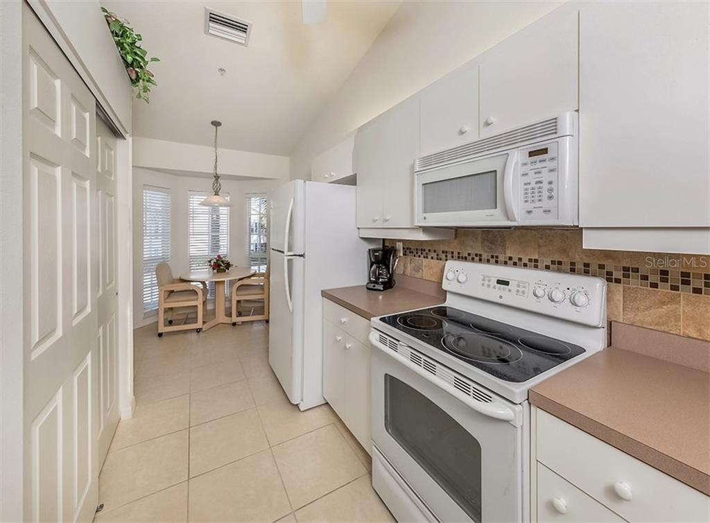 Kitchen to breakfast nook - Condo for sale at 891 Norwalk Dr #205, Venice, FL 34292 - MLS Number is N6108169