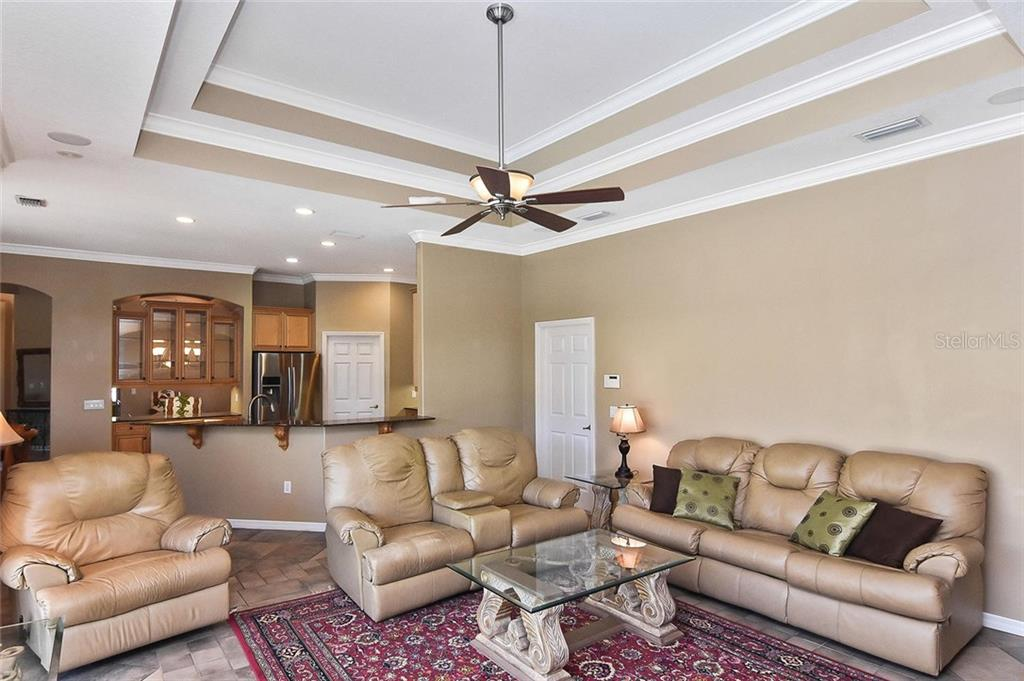 Family room, kitchen - Single Family Home for sale at 321 Dulmer Dr, Nokomis, FL 34275 - MLS Number is N6108685
