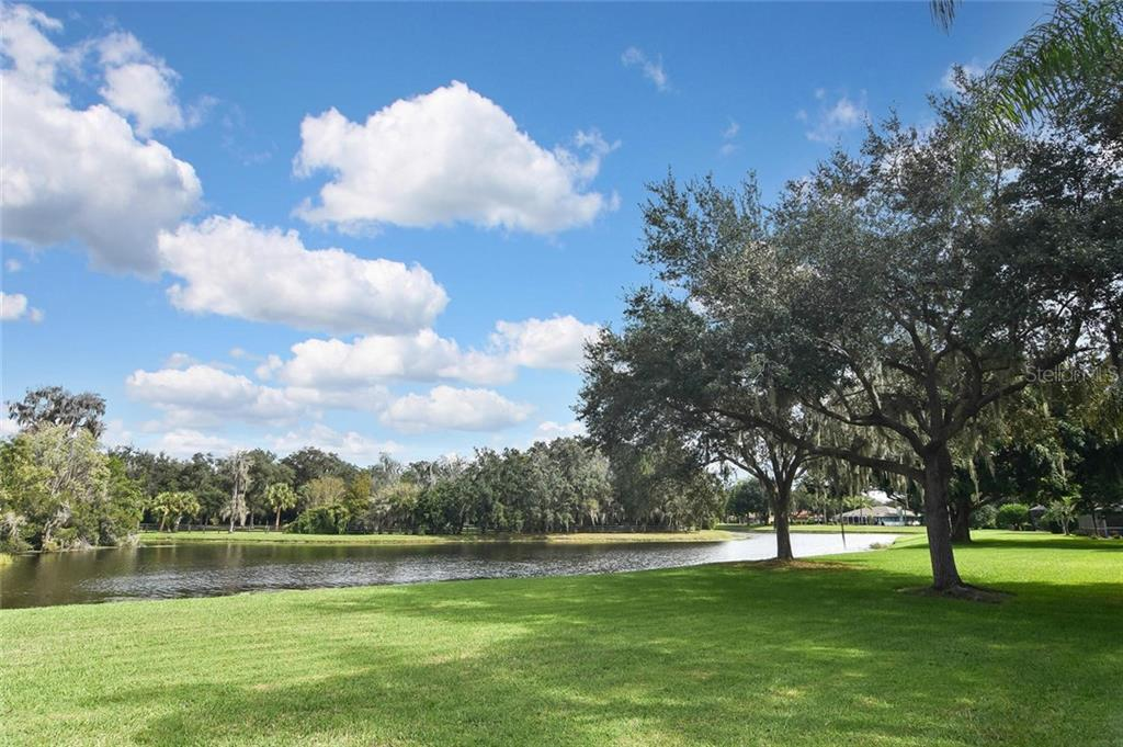 Peaceful backyard with lake view - Single Family Home for sale at 7185 N Serenoa Dr, Sarasota, FL 34241 - MLS Number is N6109058