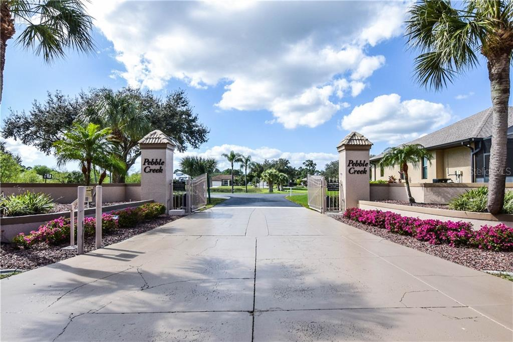 Gated entry to subdivision. - Single Family Home for sale at 2560 Pebble Creek Pl, Port Charlotte, FL 33948 - MLS Number is N6109100