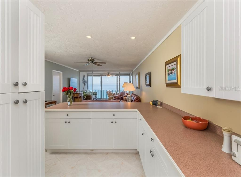 Kitchen to living room - Condo for sale at 555 The Esplanade N #1004, Venice, FL 34285 - MLS Number is N6109326
