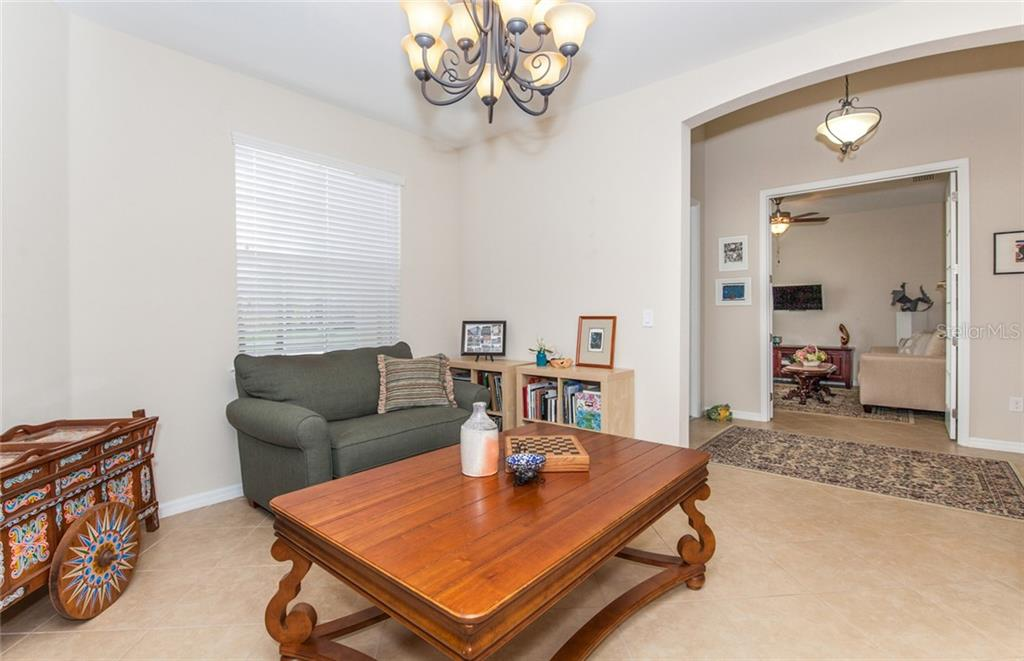 Den or formal dining room - Single Family Home for sale at 5392 Layton Dr, Venice, FL 34293 - MLS Number is N6109506
