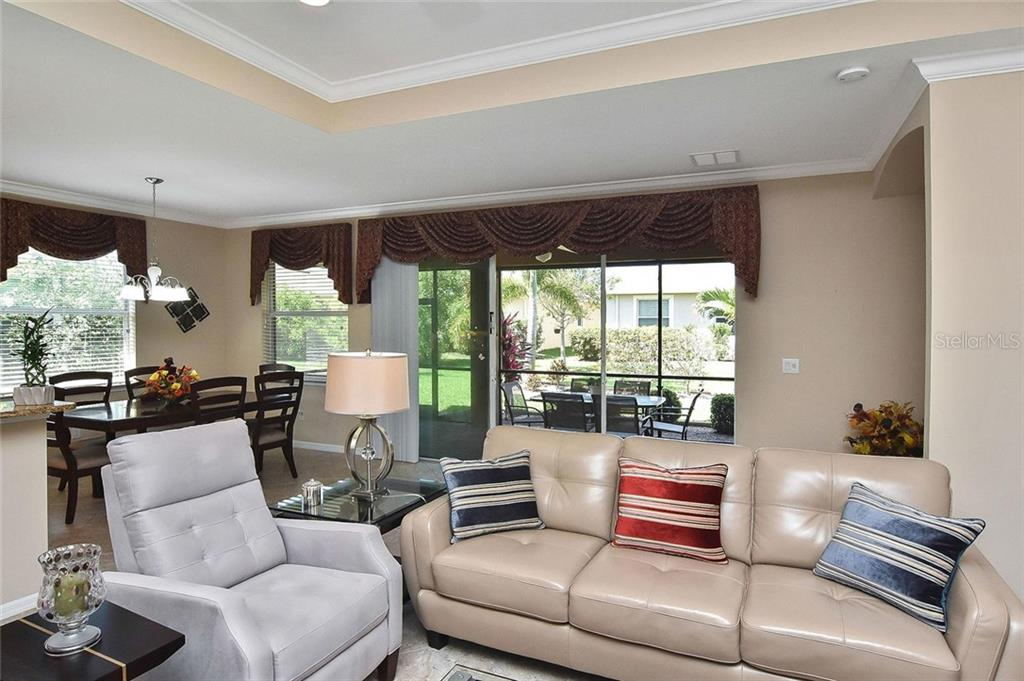 Great room to dining room - Single Family Home for sale at 5093 Layton Dr, Venice, FL 34293 - MLS Number is N6109788