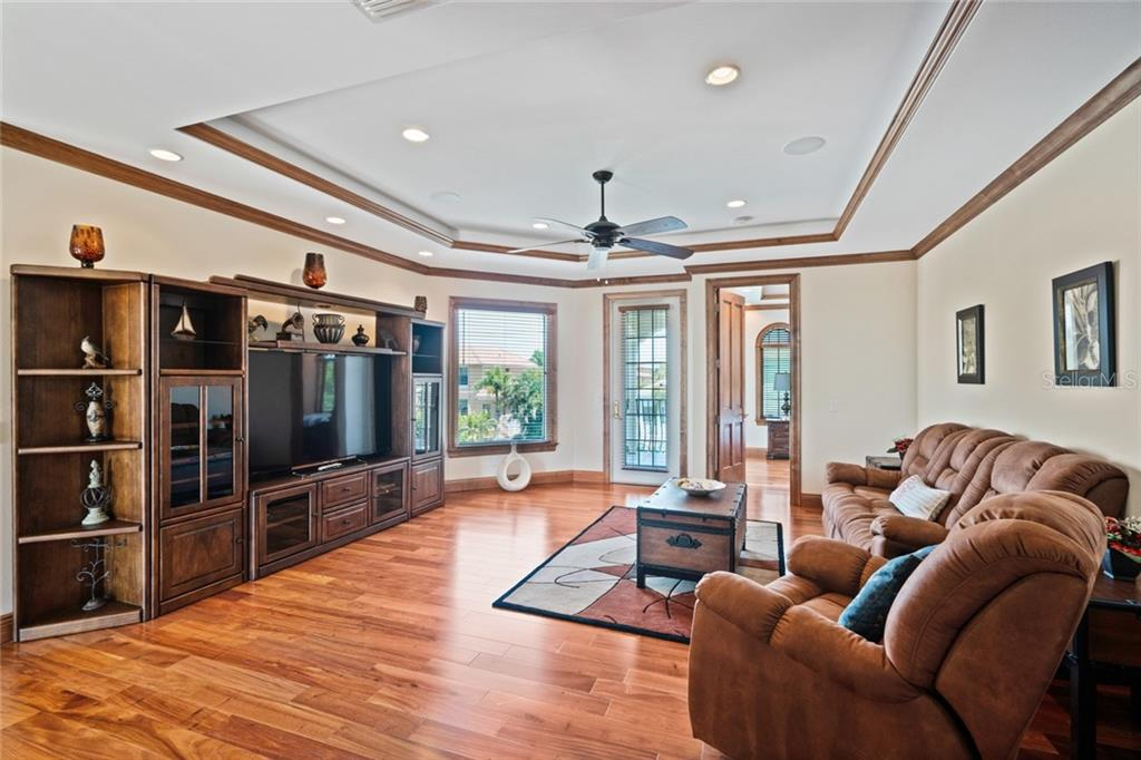 Up Stairs Family/Bonus Room with tray ceiling and Crown Moldings - Single Family Home for sale at 510 Bowsprit Ln, Longboat Key, FL 34228 - MLS Number is N6110334
