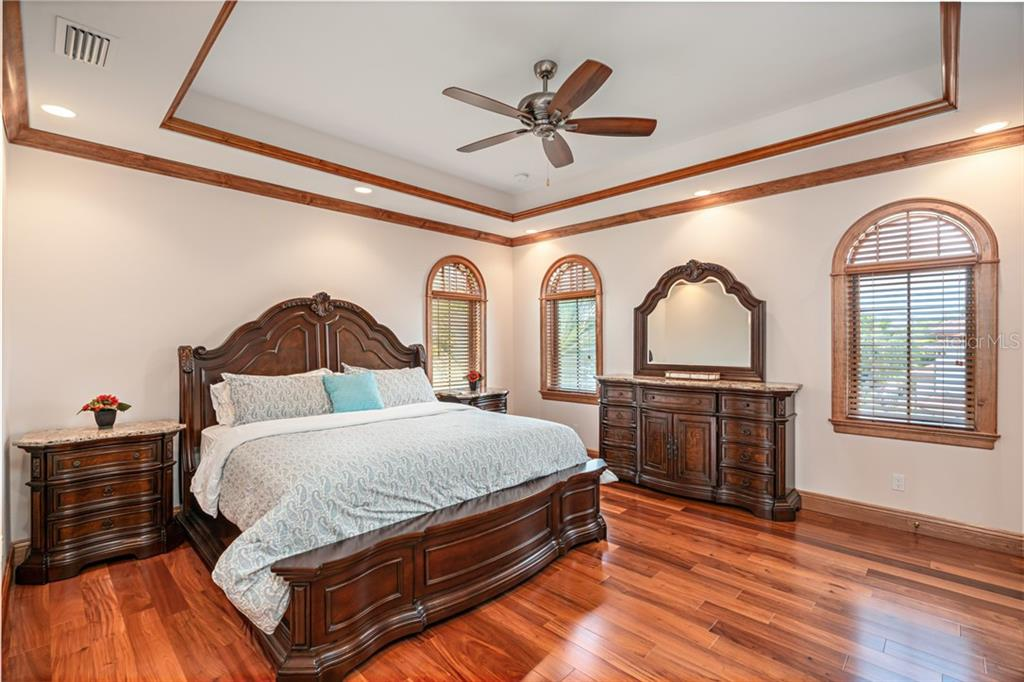 #2 Master Suite on 2nd Floor -Tray ceiling, crown molding, hardwood flooring - Single Family Home for sale at 510 Bowsprit Ln, Longboat Key, FL 34228 - MLS Number is N6110334