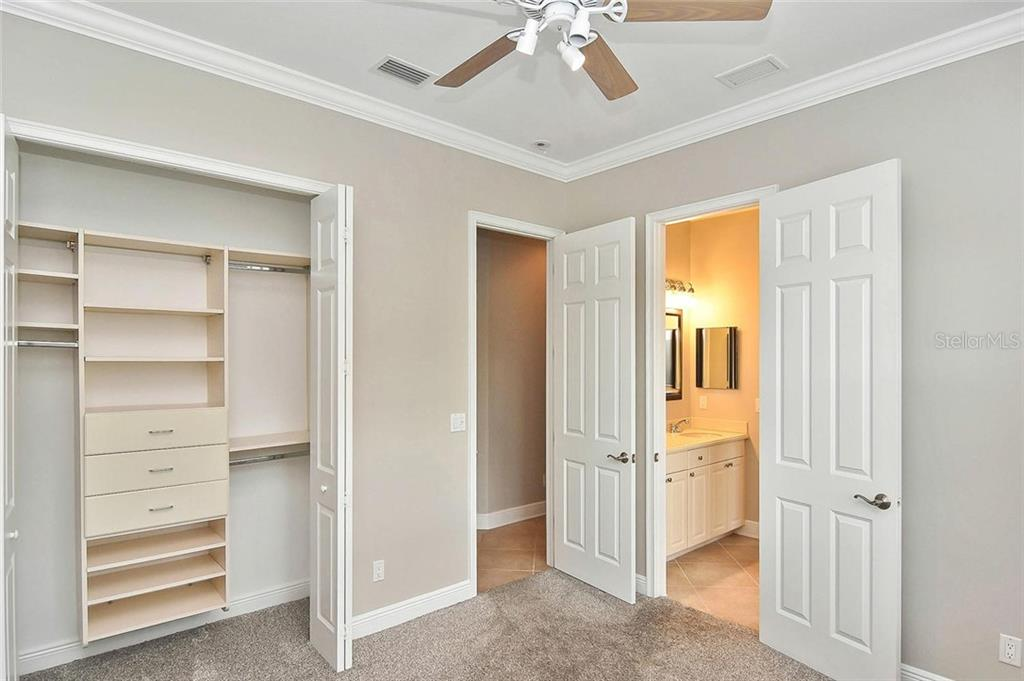 Bedroom to bathroom - Single Family Home for sale at 193 Medici Ter, North Venice, FL 34275 - MLS Number is N6110365