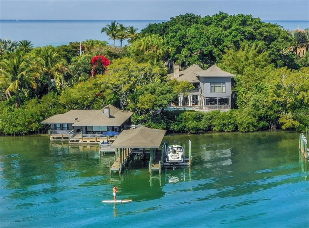 Aerial of boathouse, guest house and main house - Single Family Home for sale at 2208 Casey Key Rd, Nokomis, FL 34275 - MLS Number is N6110959